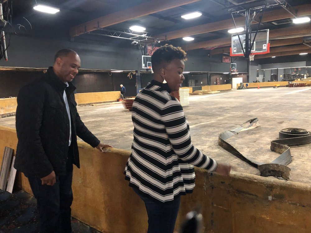 Pastor Les Simmons and his wife, Katrina, look over the former CalSkate facility off of Mack Road, which they have been converting into a community center for youth.