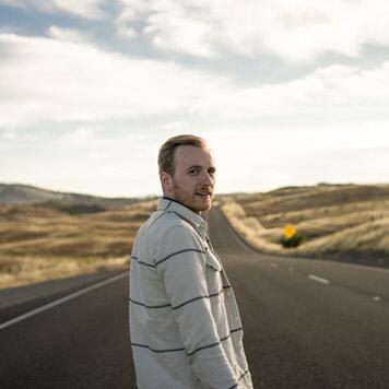 Yosemite road portrait of Kyle by Jaclyn Le