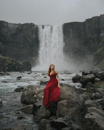 Waterfall portrait of Kelsey Johnson in Iceland