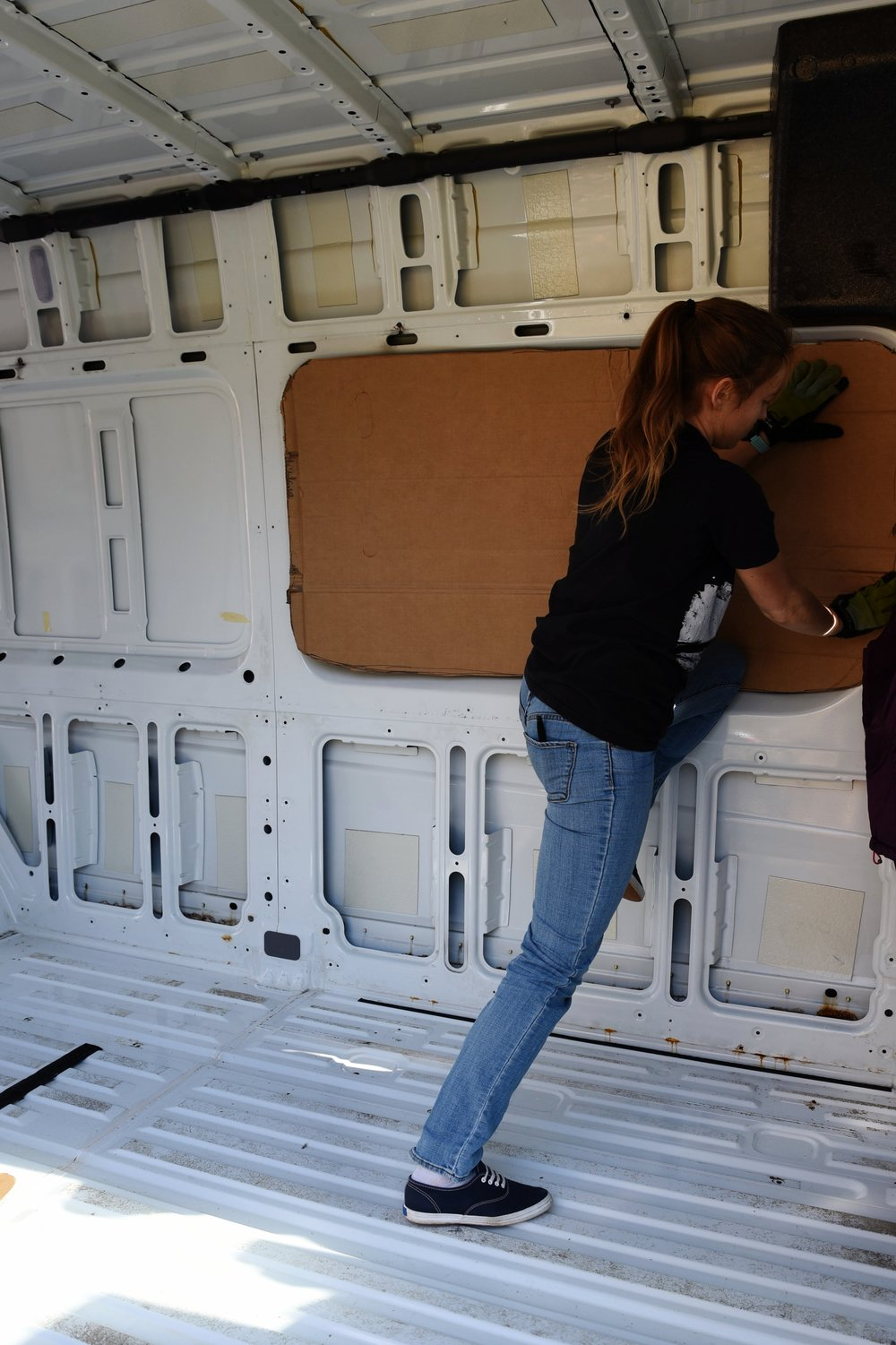 Kaylee test fits the template inside the van.