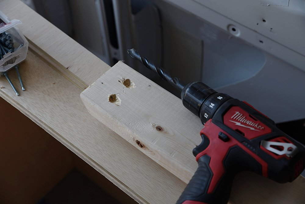 We just used a very large drill bit to create the recessed holes for the screws.