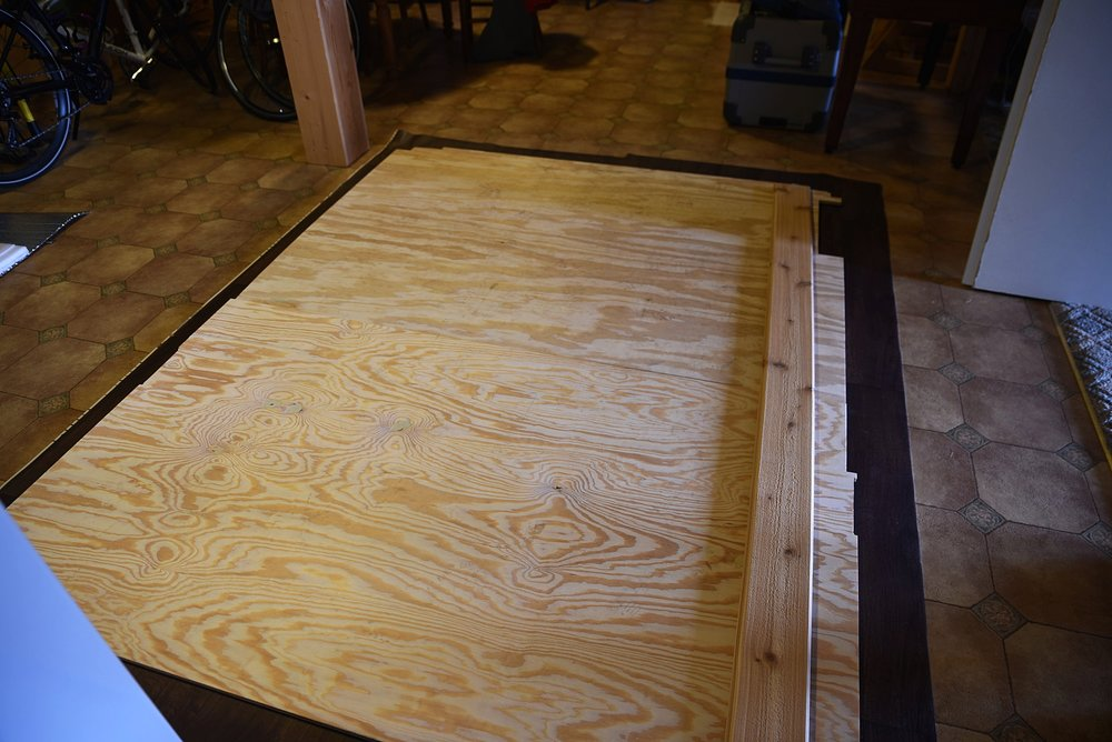 We used the plywood underlayment as a template to cut the vinyl to the correct size and shape.
