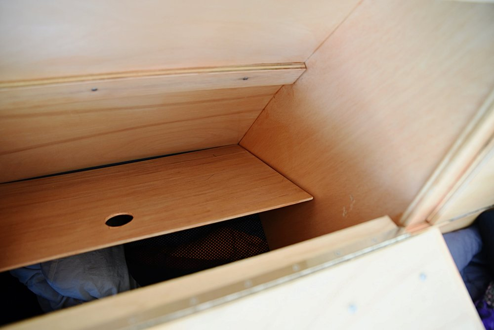 The cabinet bottoms are removable in case we ever need to access the things we store underneath.