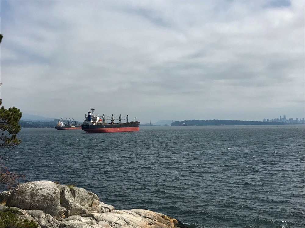 Cargo ships coming to port in English Bay outside Vancouver.