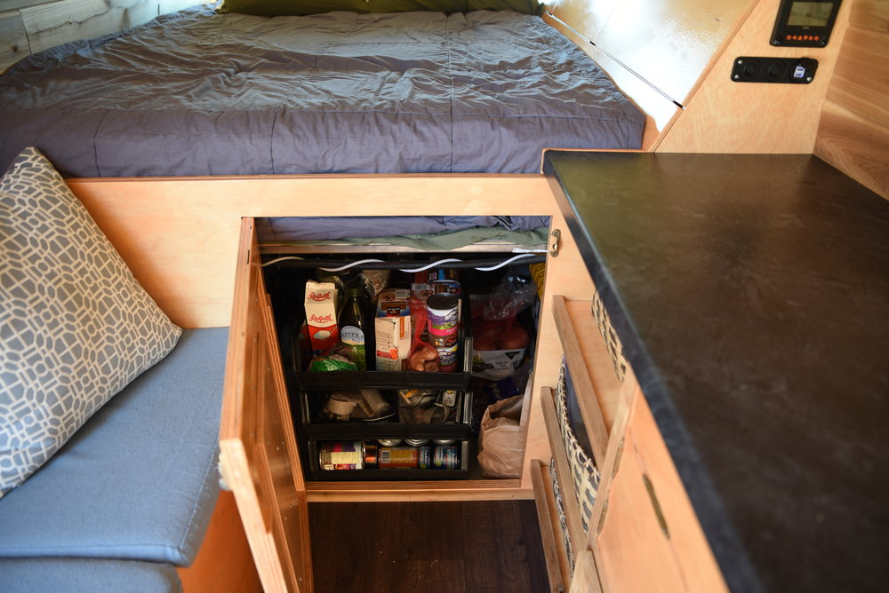 The large door in the front of our bed cabinetry gives us a place to store food and a little hobbit door if we want to get underneath.