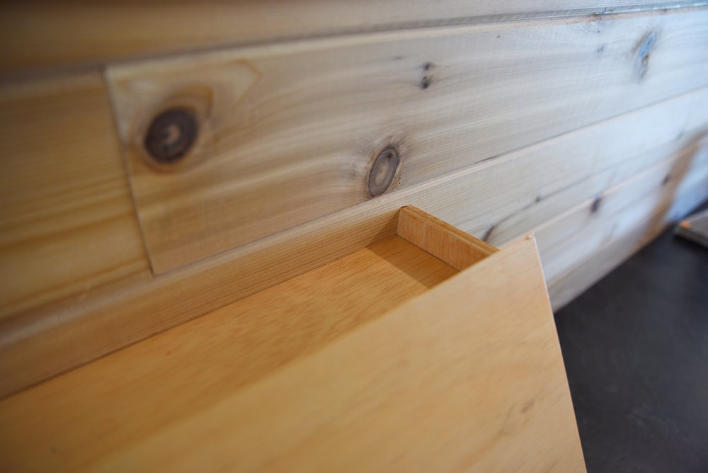 The board above our bed cabinetry required a ripping half of the board and cutting a notch.