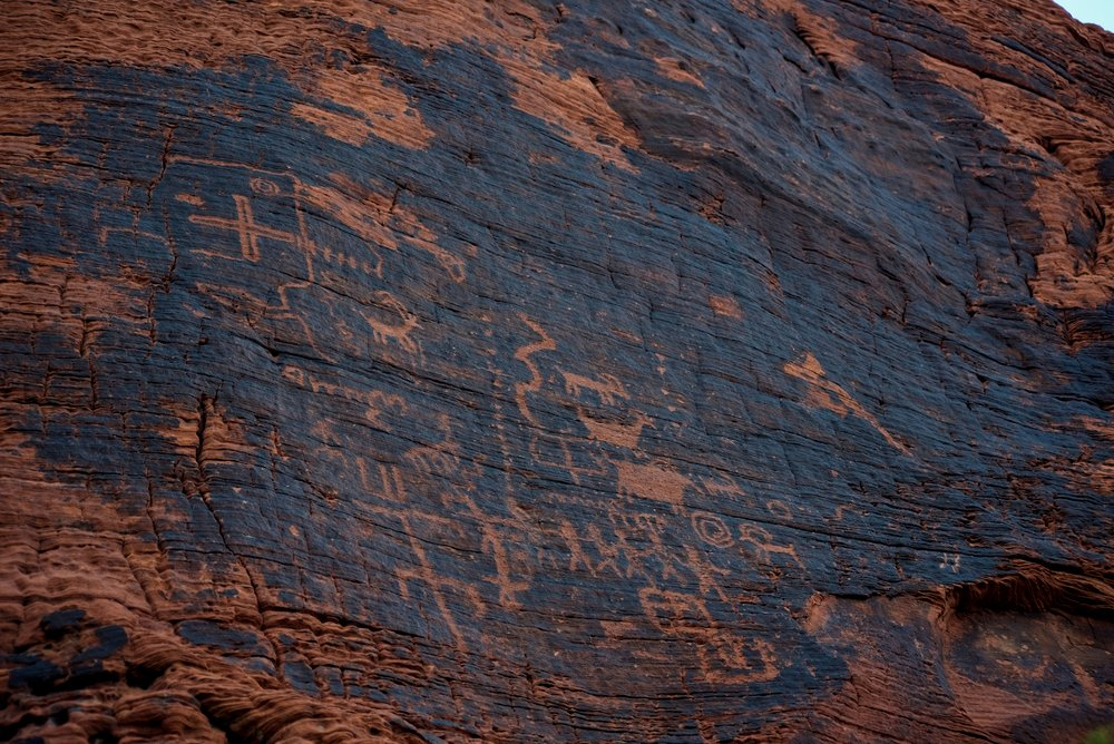 "There is a reason that the hike is also called ""Petroglyph Canyon."" Hundreds of petroglyphs line the walls."
