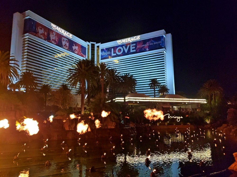 Fire balls shooting out of the Mirage's reflecting pool as part of their Volcano show.