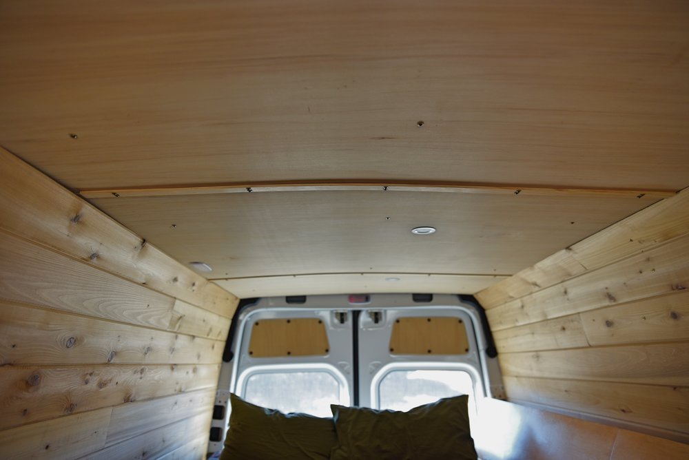 Our ceiling has four pieces of paneling with the seams running widthwise across the van.