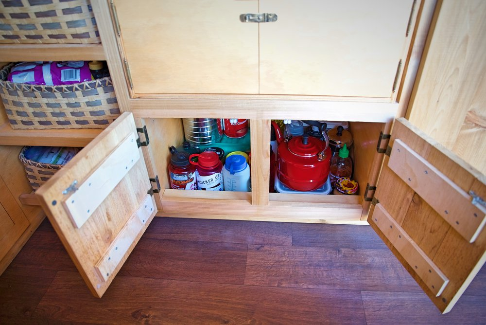 Under our chuck box we have a large storage area for things like our tea kettle and water bottles.
