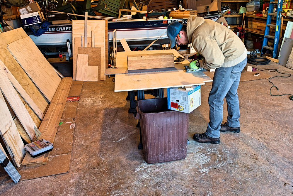 Ian prepares to cut the case of one cabinet. You can support the cut using saw horses if you're working by yourself.