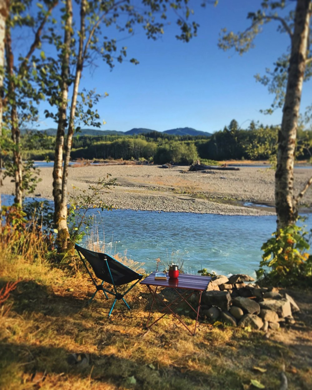 Using our Helinox chair and our Trekology table by the Hoh River in Washington.