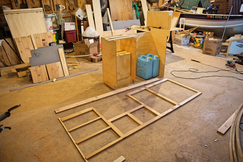 Here is the finished face frame laid out in front of the cabinet cases.