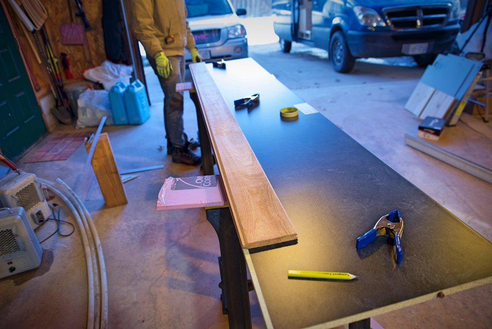 This board is the first board in our paneling above the counter, and we used it to make sure we had the right length before cutting our counter.