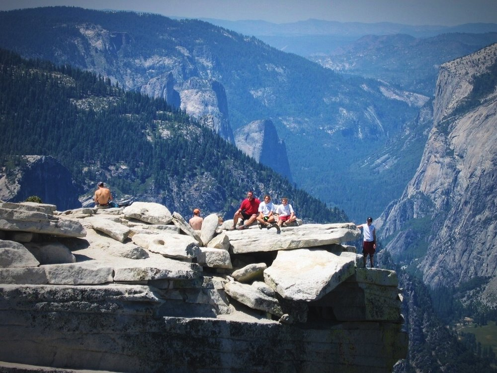 Ian's family on the summit of Half Dome on a beautiful sunny day during their first Yosemite vacation.