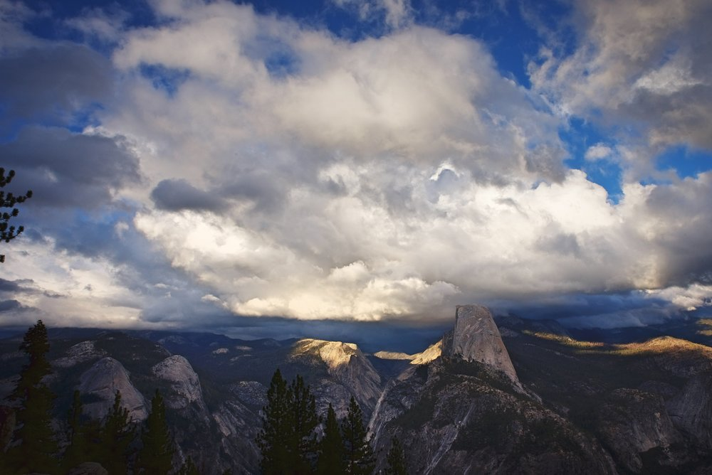 Washburn Point shows you less of the North Face of Half Dome and more of the actual dome.