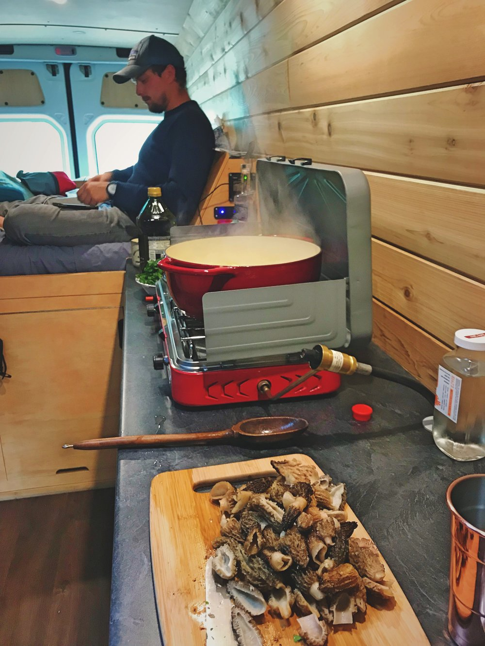 Here we are cooking some morels we foraged in Montana.