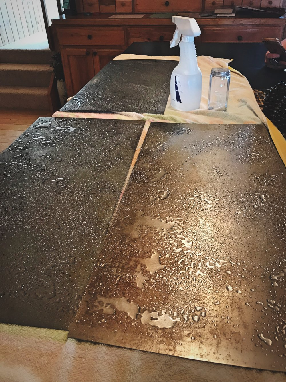 To create a rusty patina for our backsplash, we catalyzed the oxidation using vinegar and salt.
