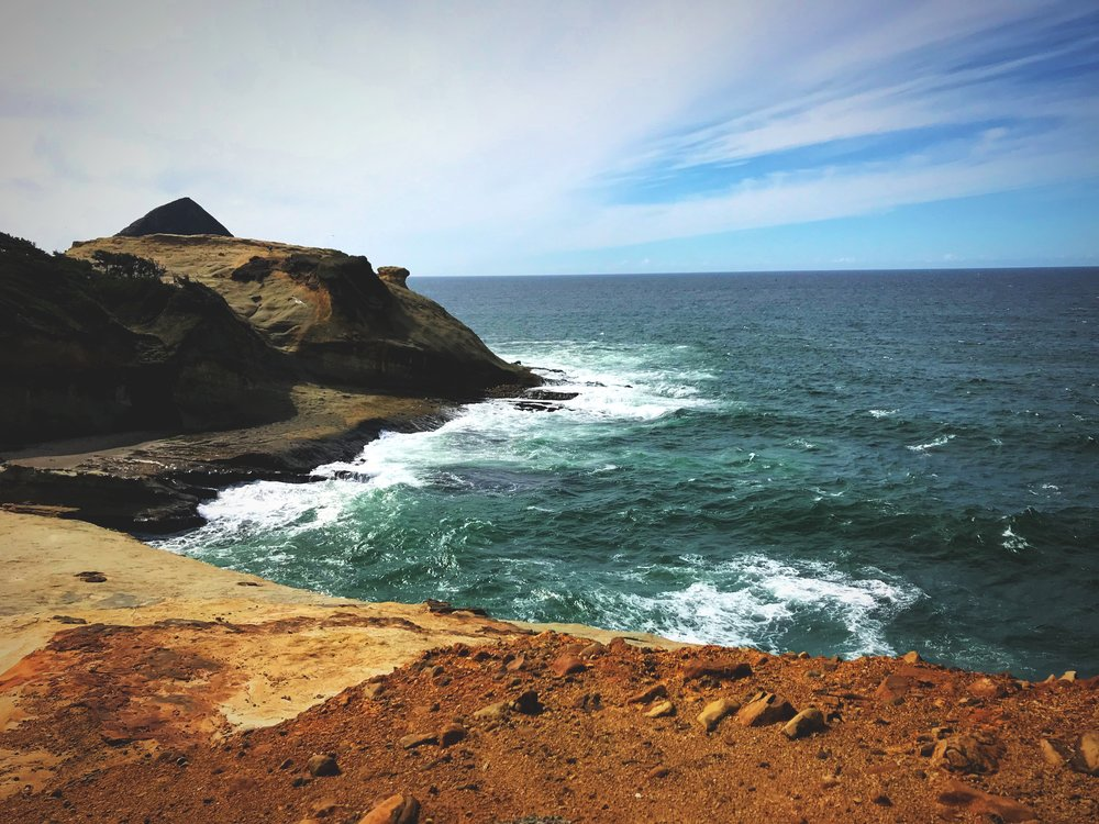 The sandstone cliffs of Cape Kiwanda are fragile and the surf is powerful.