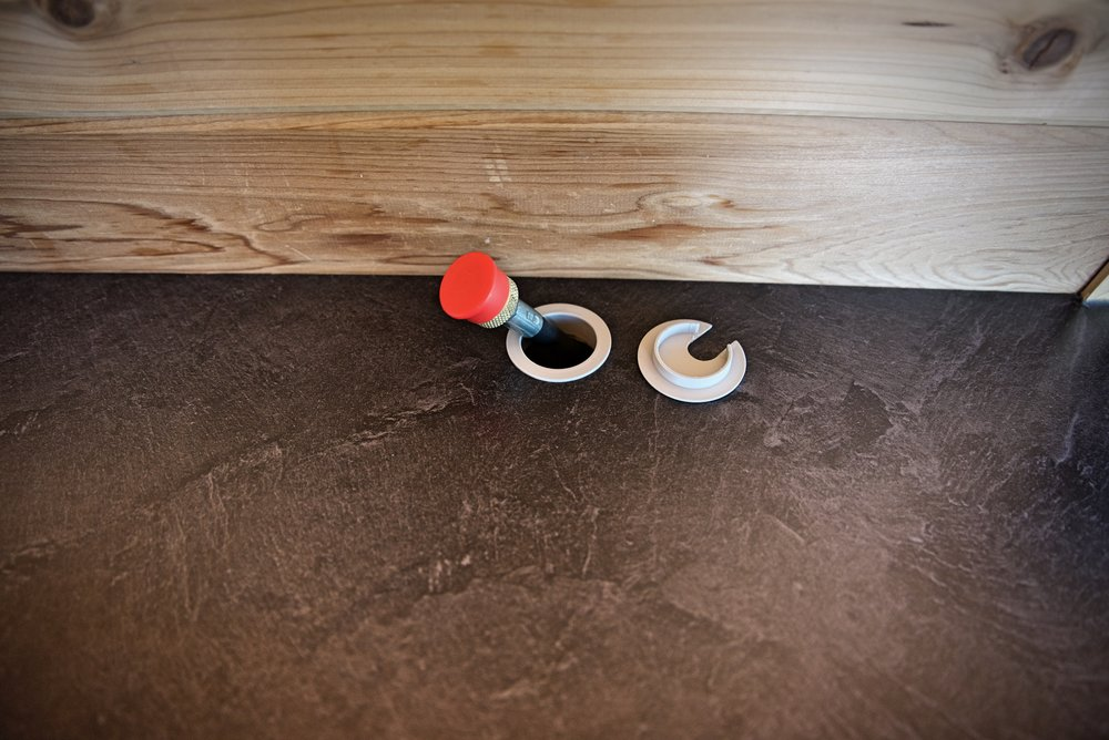 We used this desk grommet to make the hole look more finished and to prevent the hose from slipping back underneath.