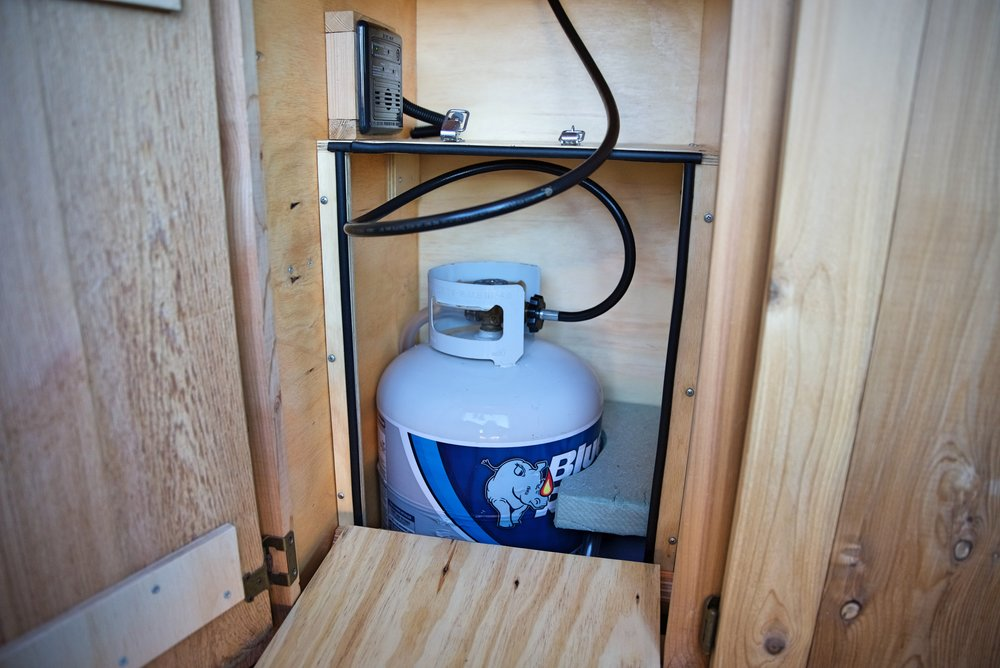 Our propane locker keeps our propane tank secure and forces any leaking propane out a hole in the bottom of the van rather than allowing it to leak into our living space.