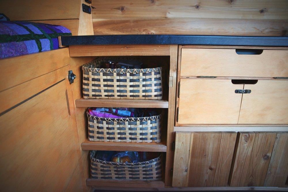 I made these baskets to fit this particular space in the van. A small lip on the shelves hold them in place while we drive.