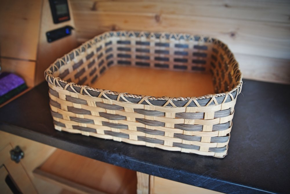 We keep utensils and dry foods in these baskets. The bottom is reinforced with a piece of 1/4-inch plywood.