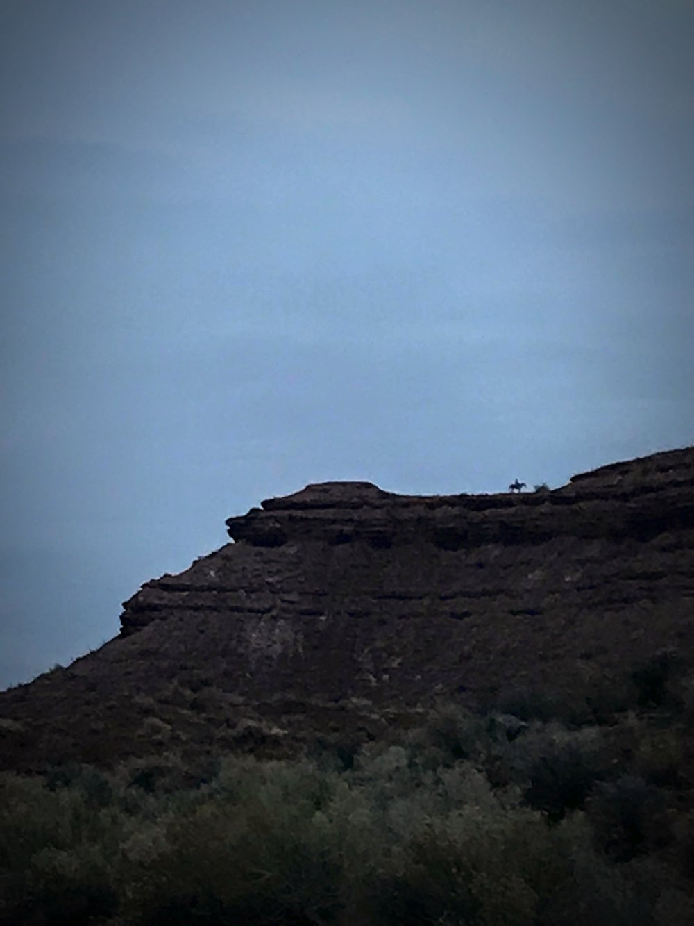 I spotted this rider high on a butte above the road. I felt like I was running through a western movie.
