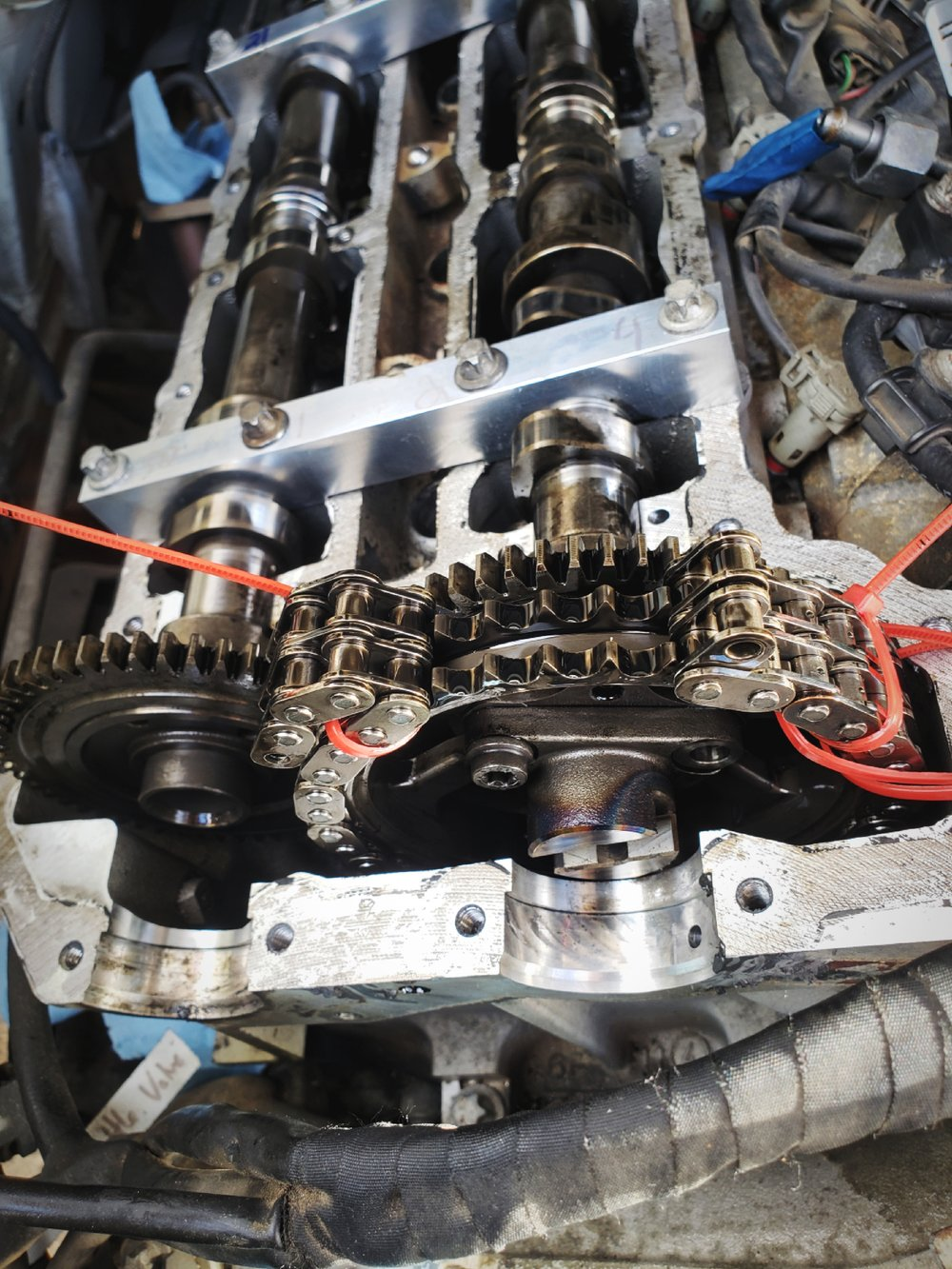 This was a scary moment—the engine open and our timing chain broken, ready for replacement.