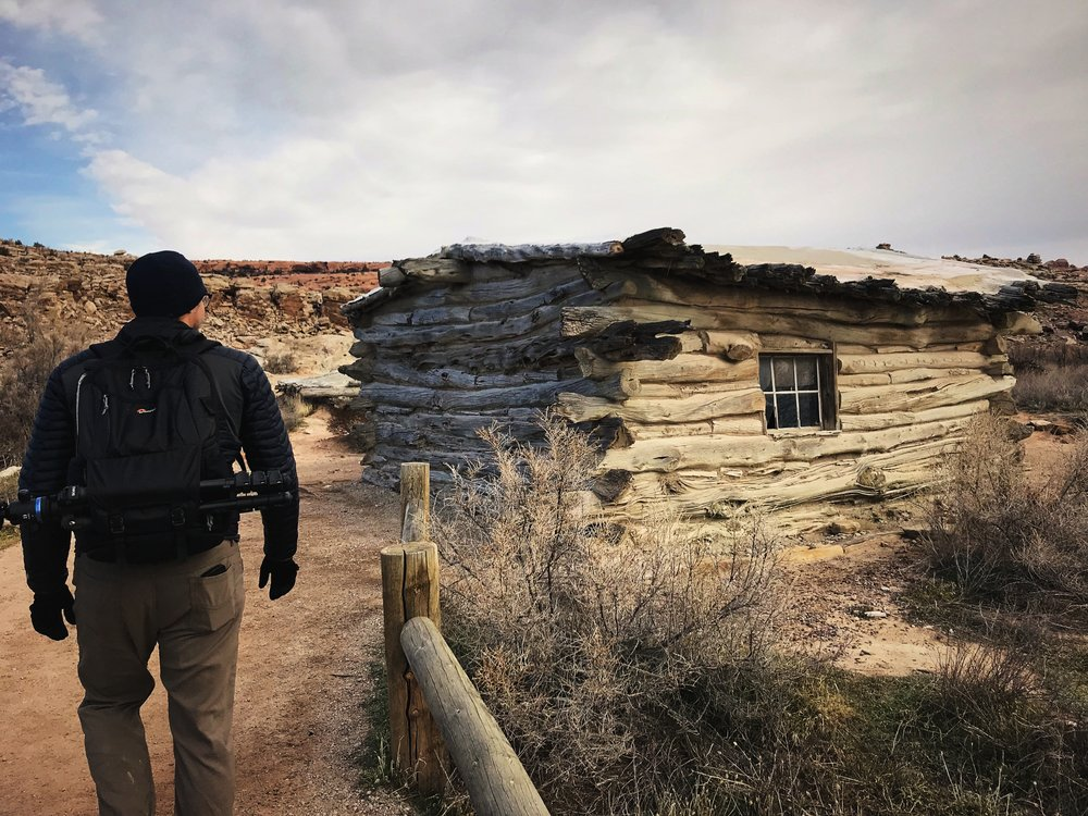 Ian walking by Wolfe Ranch on the way to Delicate Arch.