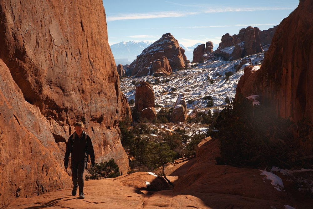 Walking up the slickrock slope to access Navajo and Partition Arch.