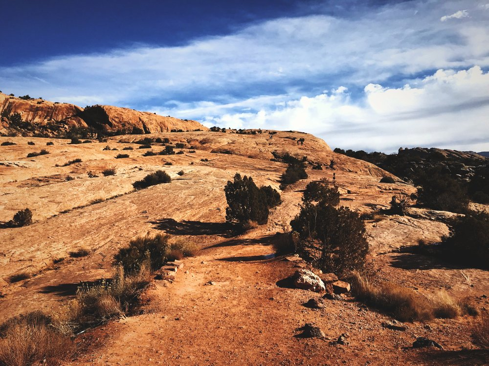 This is the long slick rock slope you have to climb to reach Delicate Arch.