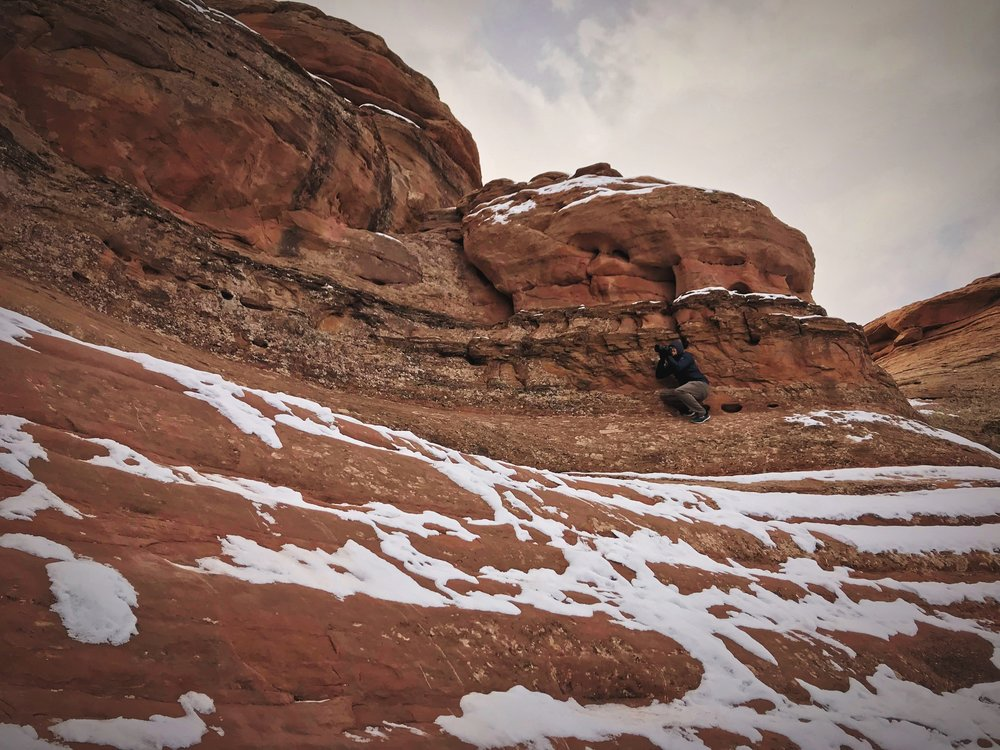 Ian photographs Delicate Arch through Frame Arch. If you didn't look carefully, you might miss him in this photo!