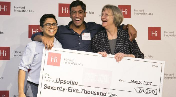 Pavuluri and Syed '18 winning the President's Innovation Challenge