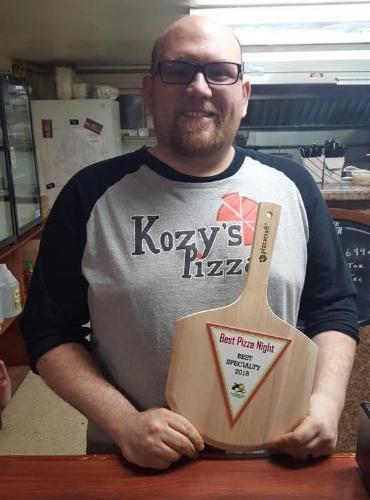 Kozy's owner Matt with award.jpg
