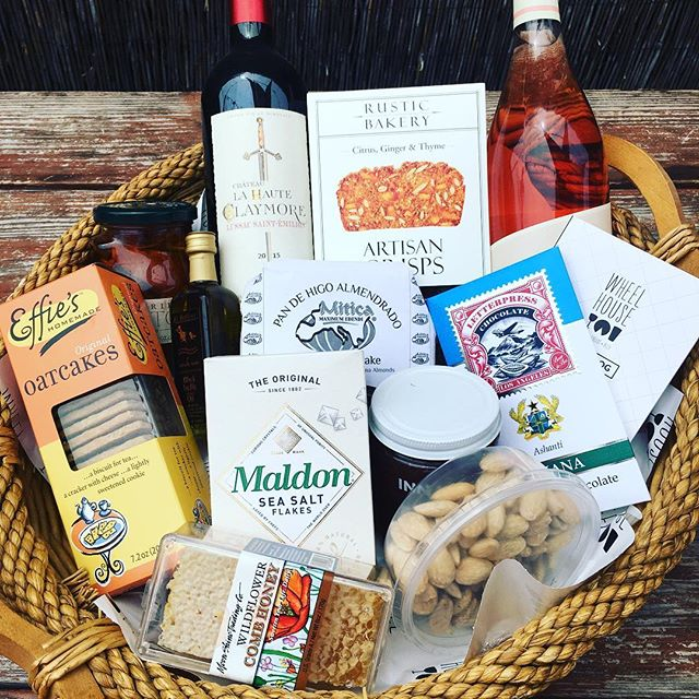 Oh ya....we do gift baskets. Not pictured a lot of awesome cheese tucked into every nook and cranny. 🤫🧀🍷❤️