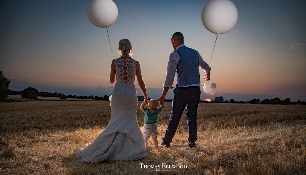 Thomas Ellwood Photography - Tom's unique style and warm personality, creates images that will melt your heart.