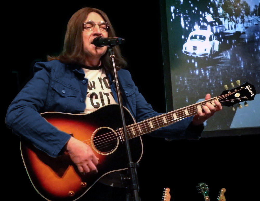Brian Mahoney as John Lennon