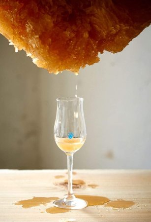 Honey being poured into wine glass
