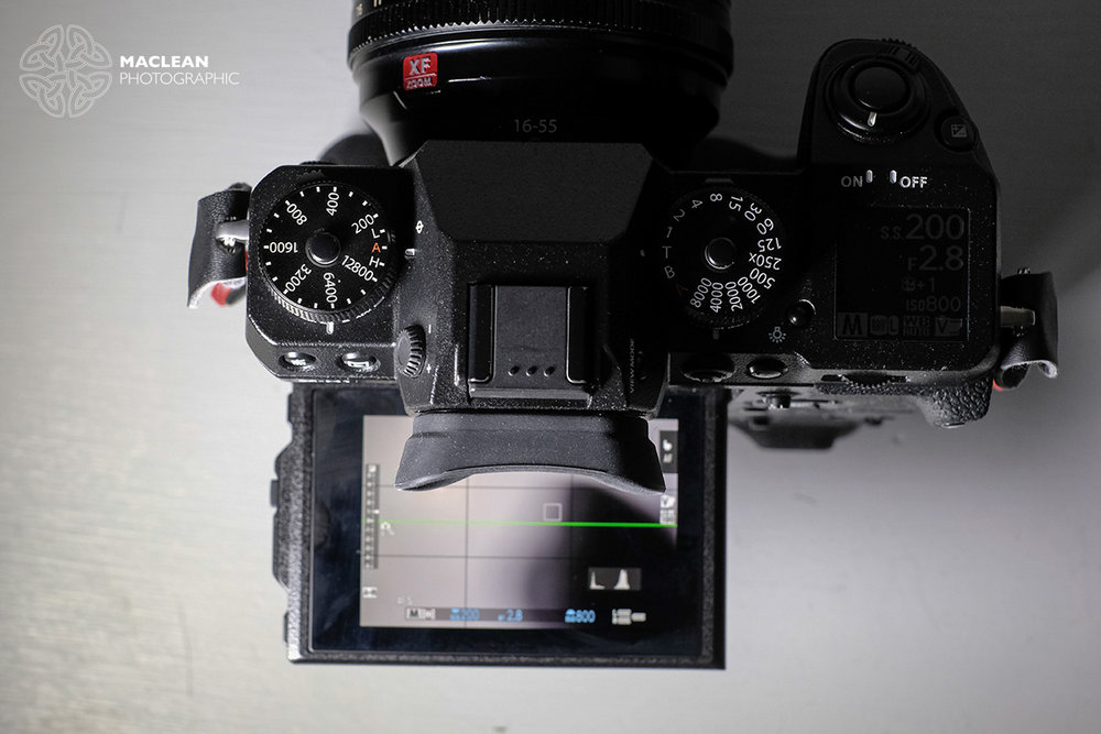 The eye cup in the X-H1 blocks the top the screen when using the camera in a low position.