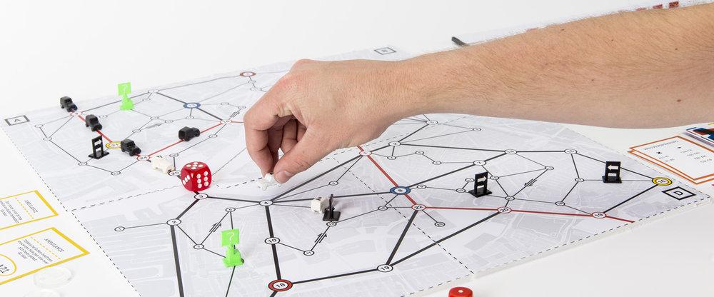 Het spelbord gebaseerd op de kaart van Rotterdam, inclusief alle drukke knooppunten van de stad.