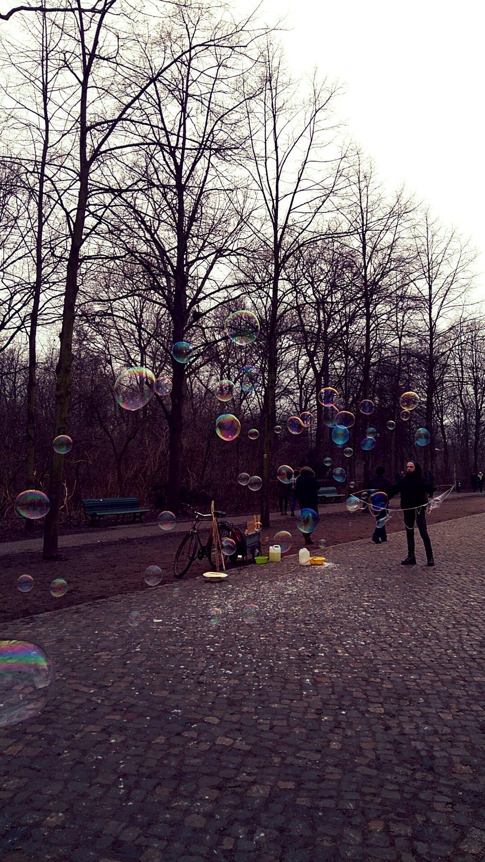 Bubbles blown behind Brandenburger Tor