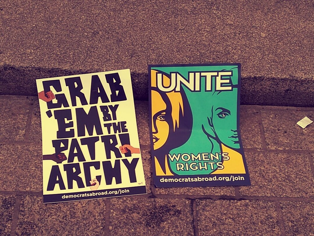 """'Democrats Abroad' posters: """"UNITE: Women's Rights"""" and """"Grab 'em by the Patriarchy"""""""