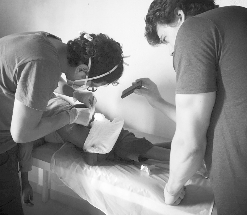 Doc Salsa and Dan work on a patient at the Waterloo Clinic, Sierra Leone.