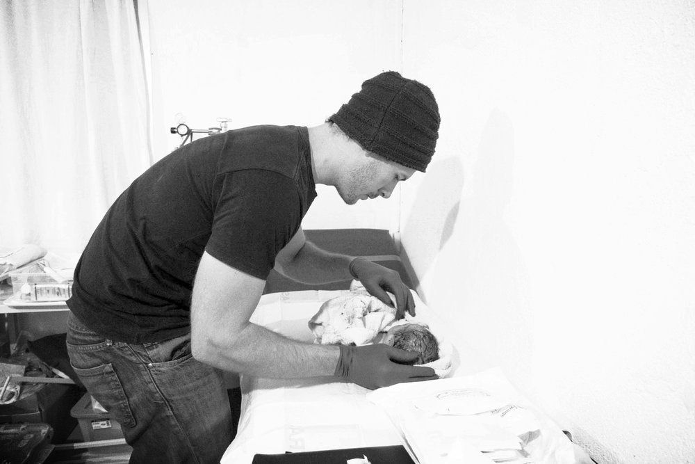 The author cleaning up his newborn buddy.