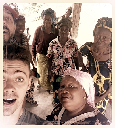 """The author (bottom left) having fun with a crew of C.A.W. widows in Kailuhan. Children Against War (C.A.W.) has invited us to work alongside them serving women who have suffered through the Ebola Crisis and The """"Blood Diamond"""" Civil War. We move into our hut in February 2019 (God willing!)"""