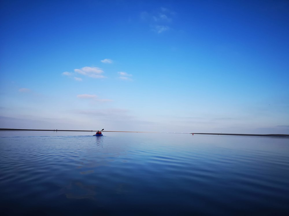 Paddling out to sea.