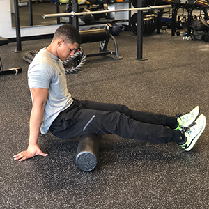 To target the hamstrings, begin sitting with the bottom of the gluteals on the roller.