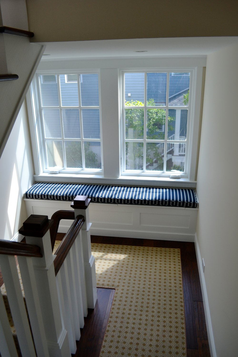 striped window seat stair landing.jpg