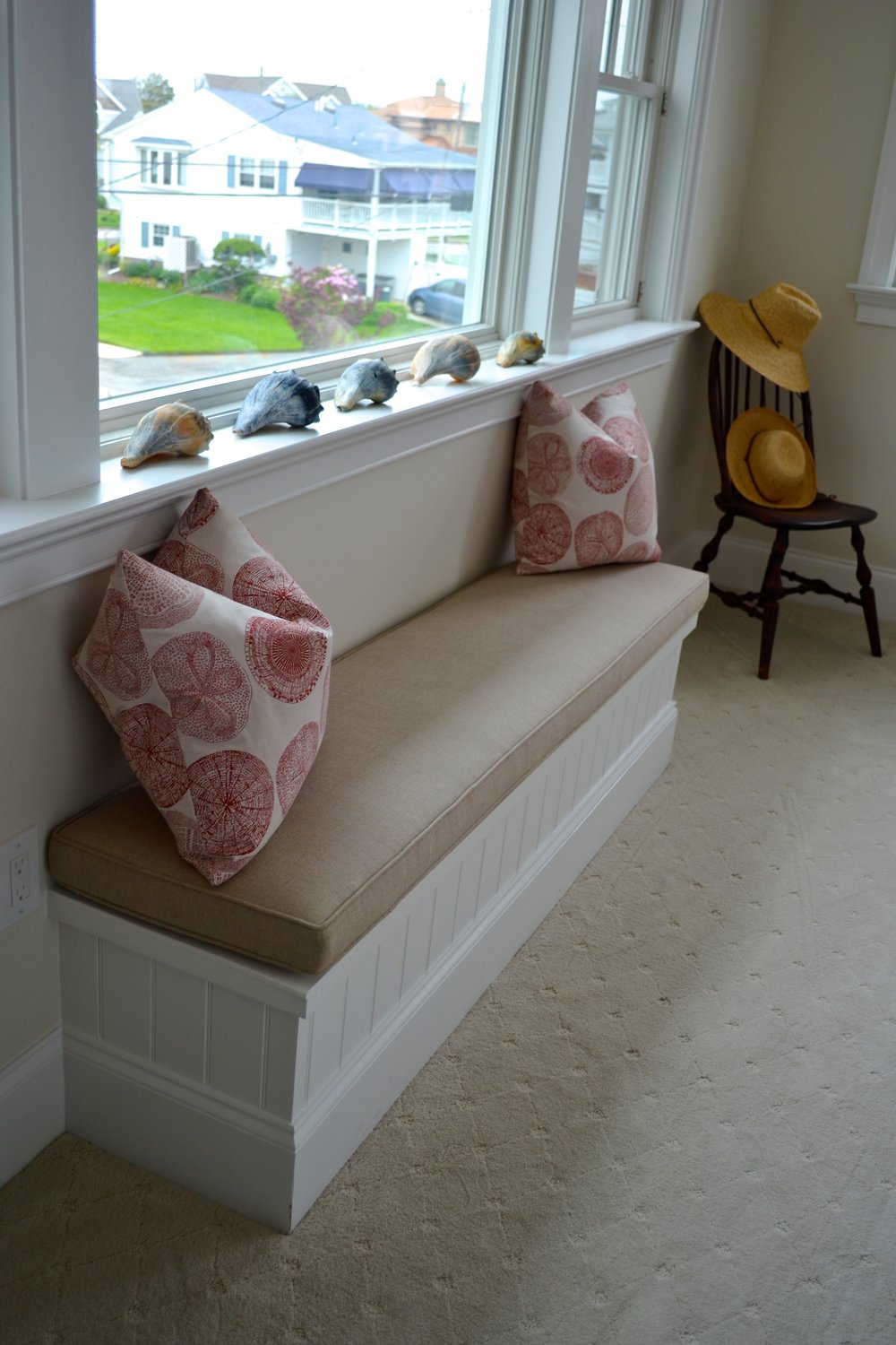 banquette window seat sanddollar pillows.jpg